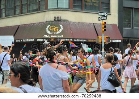 NEW YORK CITY - JUNE 16: The annual Gay Pride Parade attracts large crowds June 16, 2010 in New York, New York. - stock photo