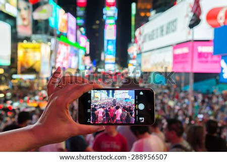 NEW YORK CITY - JUNE 13, 2015: Times Square from a smartphone, the busy tourist intersection of neon art and commerce of New York City - stock photo