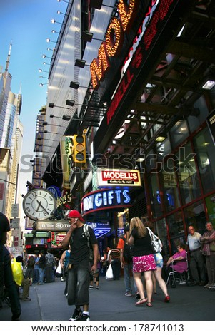 NEW YORK CITY - JUNE 26: Times Square, is a busy tourist intersection of neon art and commerce of New York City and USA at night on June 26, 2008 in Manhattan, New York , NY  - stock photo