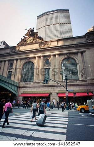 NEW YORK CITY - JUNE 29: Traffic outside historic Grand Central Terminal in NYC on June 29, 2012. The world's largest train station, Grand Central has more than 44 platforms and 67 tracks. - stock photo