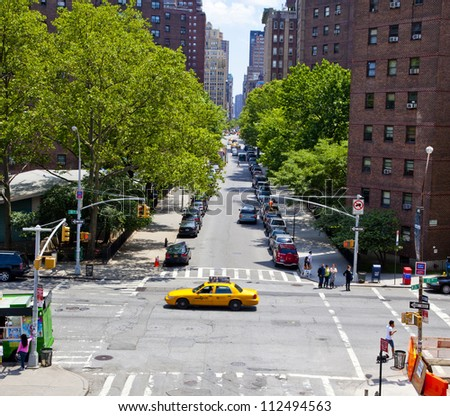 NEW YORK CITY - JUNE 3: Typical brownstone buildings in New York's fashionable Chelsea district, June 3, 2012 in New York City - stock photo