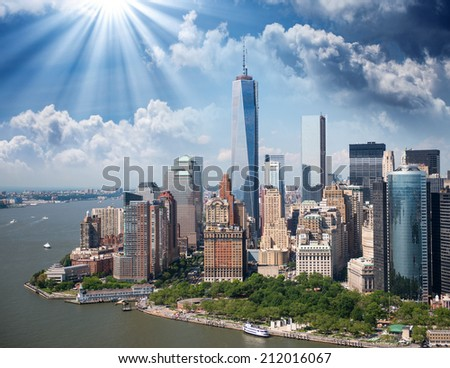 New York City Manhattan downtown aerial panorama view with skyscrapers and blue sky in the day. - stock photo