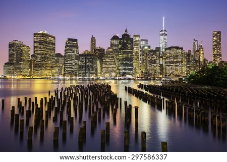 New York City Manhattan downtown skyline at dusk, USA.  - stock photo