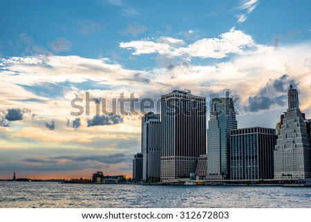 New York City Manhattan downtown skyline at dusk with skyscrapers over Hudson River panorama - stock photo