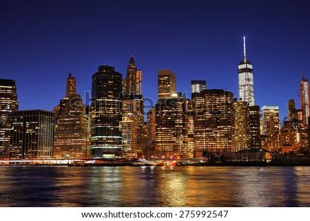 New York City Manhattan downtown skyline at night with illuminated skyscrapers   - stock photo