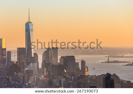 New York City. Manhattan downtown skyline with illuminated Empire State Building and skyscrapers at sunset seen from Top of the Rock observation deck. Vertical composition Fish eye lens shot. - stock photo