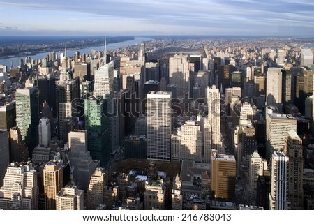 New York City Manhattan midtown aerial panorama view with skyscrapers and blue sky in the day. - stock photo