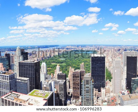New York City Manhattan midtown aerial panorama view with skyscrapers and central park in the day. - stock photo