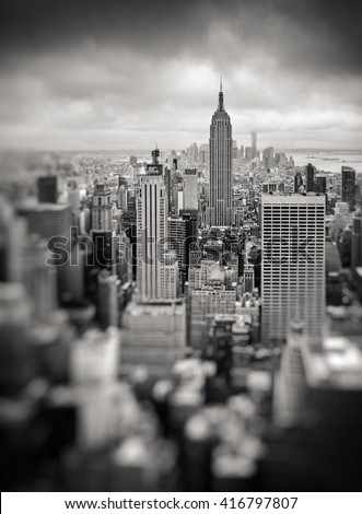 New York City Manhattan midtown aerial view with skyscrapers on an overcast day. Black and white image with a blurred foreground - stock photo