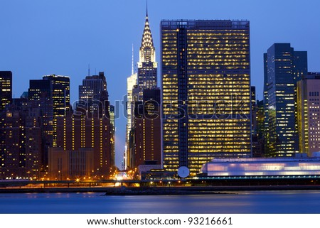 New York City  Manhattan midtown skyline over East River at dusk - stock photo