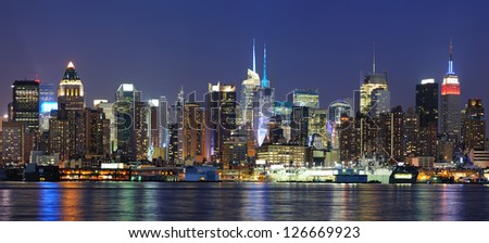 New York City Manhattan midtown skyline panorama at dusk with historical landmark skyscrapers over Hudson River viewed from New Jersey Weehawken waterfront. - stock photo