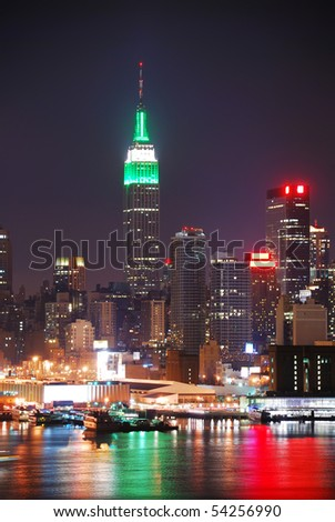 New York City Manhattan night scene with Empire State Building over Hudson River. - stock photo