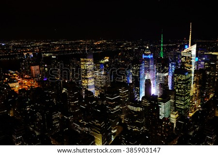 New York City Manhattan panorama aerial night view at with office building skyscrapers skyline illuminated. The New York City downtown panorama in the night. - stock photo