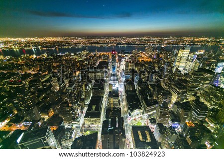 New York City Manhattan panorama aerial view at night with office building skyscrapers skyline illuminated - stock photo