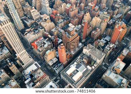 New York City Manhattan skyline aerial view with street and skyscrapers at sunset. - stock photo