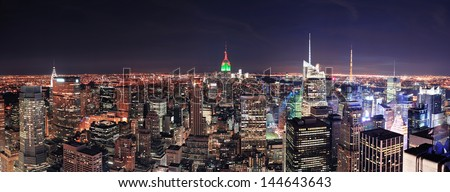 New York City Manhattan skyline at night panorama with urban skyscrapers. - stock photo