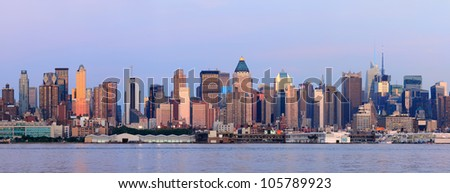 New York City Manhattan sunset panorama with historical skyscrapers over Hudson River viewed from New Jersey Weehawken waterfront at dusk with tranquil blue tone. - stock photo