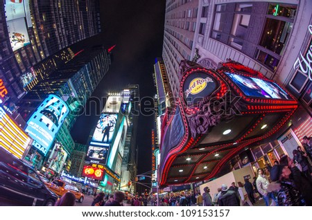 NEW YORK CITY - MAR 8: Times Square is a busy tourist intersection of neon art and commerce and is an iconic street of New York City and America, March 8th, 2011 in New York City. - stock photo