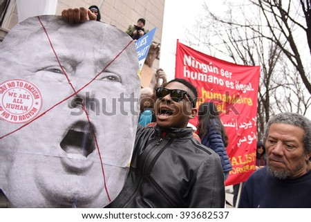 NEW YORK CITY - MARCH 19 2016: A thousand activists gathered at Columbus Circle to oppose Republican front-runner Donald Trump, marching to Trump Tower during which NYPD officers made several arrests. - stock photo