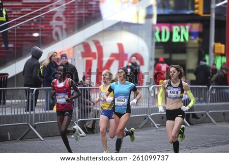 NEW YORK CITY - MARCH 15 2015: the New York Road Runners held its annual Half Marathon that started on the Upper East Side, passed through Times Square & culminated on Wall Street - stock photo