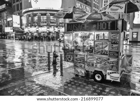 NEW YORK CITY - MAY 21: A hot dog stand vendor stays open late into the night to sell a few more hot dogs to late night tourists, May 21, 2013 in NYC. - stock photo