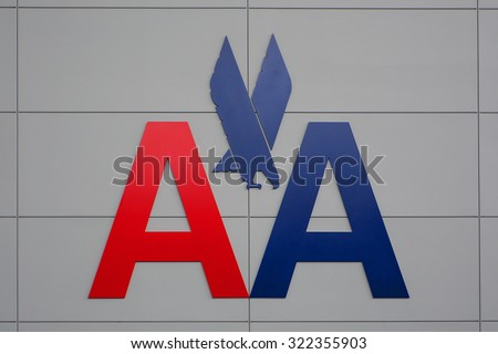 NEW YORK CITY - MAY 20, 2015: American Airlines logo on JFK airport wall. American Airlines is the world's largest airline with 108 million passengers. - stock photo
