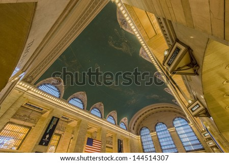 NEW YORK CITY - MAY 21: Interior of Grand Central Station on May 21, 2013 in New York City, NY. The building celebrated its 100 Year Anniversary in 2013 and attracts over 20 million visitors annually - stock photo