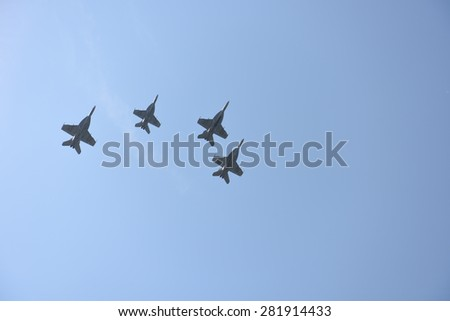 NEW YORK CITY - 25 MAY 2015: Mayor Bill de Blasio & Gen John Kelly presided over Memorial Day observances on Pier 86 by the USS Intrepid. Jets fly over pier 86 in formation - stock photo