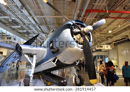 NEW YORK CITY - 25 MAY 2015: Mayor Bill de Blasio & Gen John Kelly presided over Memorial Day observances on Pier 86 by the USS Intrepid. Prop airplane with wings folded in hanger deck of USS Intrepid - stock photo