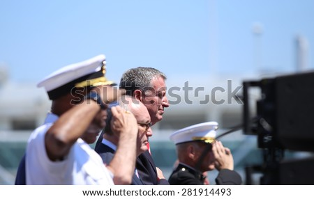NEW YORK CITY - 25 MAY 2015: Mayor Bill de Blasio & Gen John Kelly presided over Memorial Day observances on Pier 86 by the USS Intrepid. Saluting for Star Spangled Banner on pier 86 - stock photo