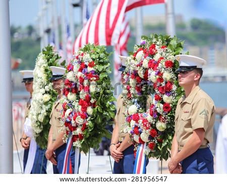 NEW YORK CITY - 25 MAY 2015: Mayor Bill de Blasio & Gen John Kelly presided over Memorial Day observances on Pier 86 by the USS Intrepid. Marine honor guard with wreaths on Pier 86 - stock photo