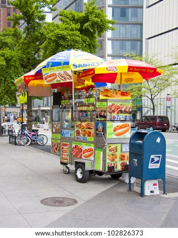 NEW YORK CITY - MAY 6: Midtown, Hot dog vendors are a staple on the streets in New York City, May 6th, 2012 in Manhattan, New York City - stock photo