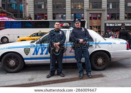 NEW YORK CITY - MAY 2015: NYPD Police Officers at Times Square. The New York City Police Department, established in 1845, is the largest municipal police force in the United States.  - stock photo