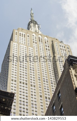 NEW YORK CITY - MAY 26 : Powerful structure of Empire state building facade, May 26, 2013 in NYC. It stood as the world's tallest building for more than 40 years (from 1931 to 1972). - stock photo