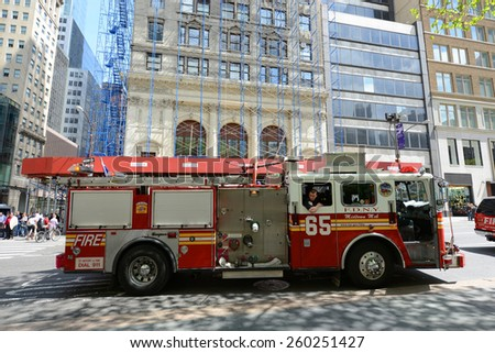 NEW YORK CITY - MAY 7: Red Fire Truck on duty at Fifth Avenue in Manhattan on May 7th, 2013 in New York City, USA - stock photo
