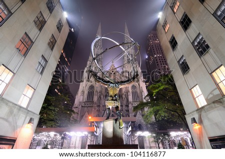NEW YORK CITY - MAY 15: St. Patrick's Cathedral behind the Atlas statue, one of 12 pieces created by sculptor Lee Lawrie in the Art Deco style for Rockefeller Center May 15, 2012 in New York, NY. - stock photo