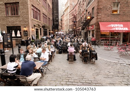 NEW YORK CITY - MAY 16: Stone Street May 16, 2012 in New York, NY. The historic street dates from 1660 and currently features outdoor dining when weather permits. - stock photo