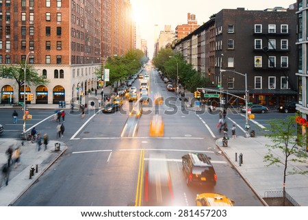 NEW YORK CITY - MAY 7, 2015: Street view from the High Line Park. The High Line is a public park built on an historic freight rail line elevated above the streets on Manhattan West Side. - stock photo