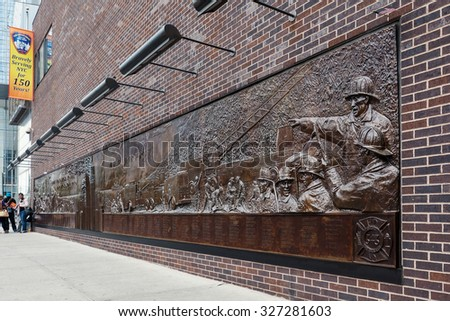 NEW YORK CITY - MAY 12, 2015: The Memorial Wall, located at FDNY Engine 10 Ladder 10, directly across from the World Trade Center site. It's dedicated to the 343 members of the NYFD who died on 9/11. - stock photo