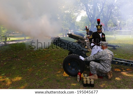 NEW YORK CITY - MAY 26 2014: The 146th annual King's County Memorial Day Parade, one of the nation's oldest, honored fallen & living veterans in the streets of Bay Ridge, Brooklyn. Howitzer salute  - stock photo