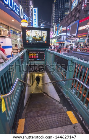 NEW YORK CITY - MAY 28: Ties Square subway station entrance at night, May 28, 2013 in New York City. New York City Subway is the seventh busiest rapid transit rail system in the world. - stock photo