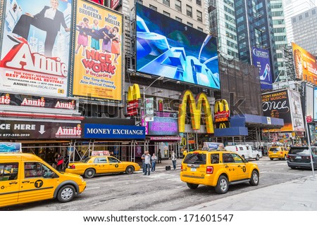 NEW YORK CITY - MAY 20: Times Square, featured with Broadway Theaters and animated LED signs, is a symbol of New York City and the United States, May 20, 2013 in Manhattan, New York City. USA. - stock photo