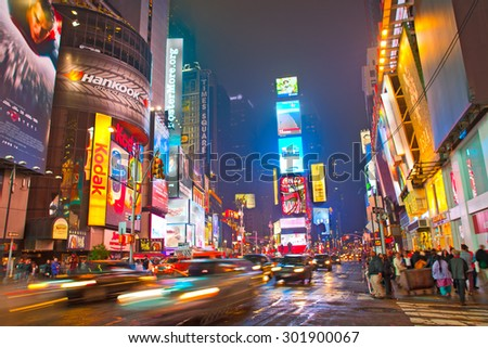 NEW YORK CITY-MAY 28, 2013:Times square in Manhattan.  New York City illuminated colorful  advertising on the buildings at night in the most famous tourist destination in USA - stock photo