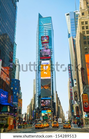 "NEW YORK CITY - MAY 12: Times Square on May 12, 2013 in New York. Iconified as ""The Crossroads of the World"" it's the brightly illuminated hub of the Broadway Theater District. - stock photo"