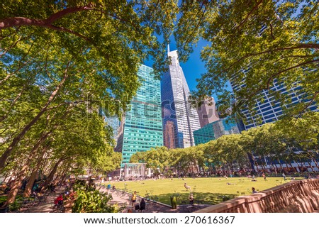 NEW YORK CITY - MAY 24, 2013: Tourists in Bryant Park. New York is visited by more than 50 million people every year. - stock photo