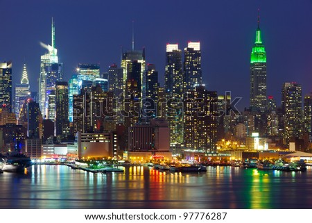 New York City midtown skyline at night over Hudson river - stock photo