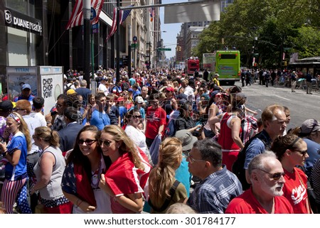New York City, New York, USA - July 10, 2015: USA women's soccer team fans cheer  during the ticker tape parade to celebrate the team FIFA World Cup victory in New York City, NY on July 10, 2015  - stock photo