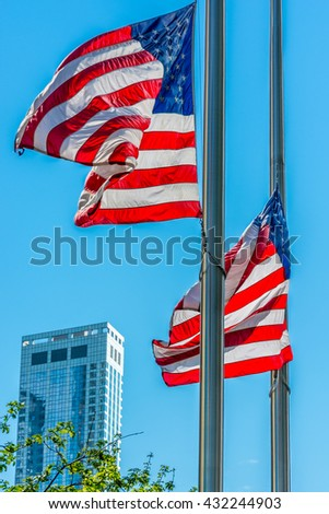 NEW YORK CITY, NEW YORK, USA â?? MAY 15, 2013: American flags in the streets of New York - stock photo