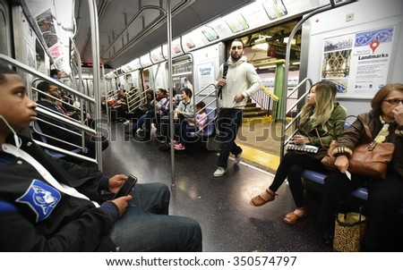 NEW YORK CITY - NOV 11: People ride subway train on Nov 11, 2015 in New York City, USA. The New York Subway has the most stations of any subway in the world at 469. - stock photo