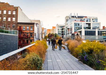 NEW YORK CITY - NOV 14: People stroll along the High Line Park in New York City on November 14, 2014. The High Line Park was formerly an elevated train track. - stock photo